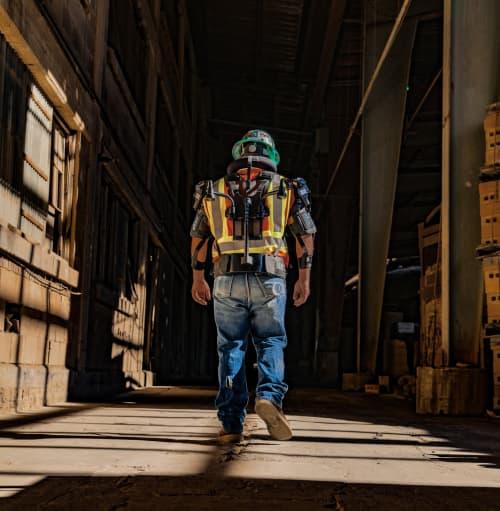 Construction worker walking while wearing full body exosksleton