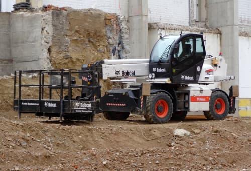Bobcat Telehandler next to broken cement wall