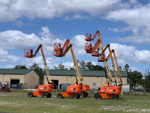 Articulating boom lifts together on a lot