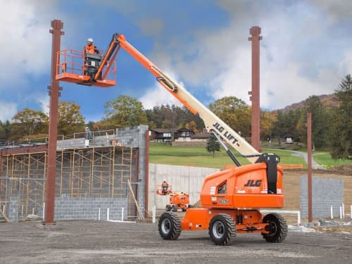 JLG boom lift with construction worker on platform