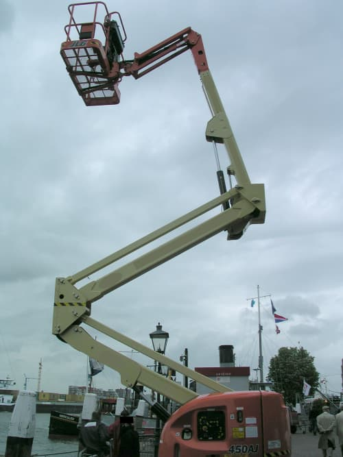 An articulating boom lift reaching out to the sky