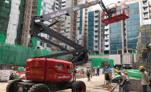 A skyjack articulating boom lift on construction site