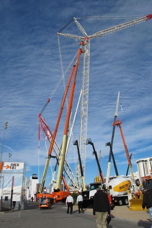 Super tall boom lifts extended up to the sky
