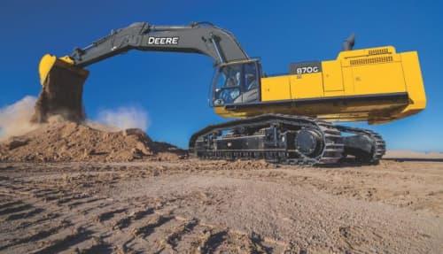 John Deere Excavator dumping dirt