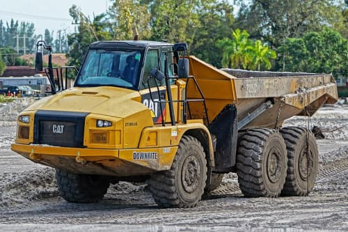 Cat rock truck driving on construction site