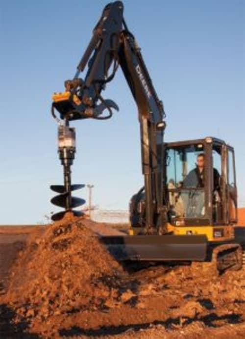 mini excavator with auger attachment