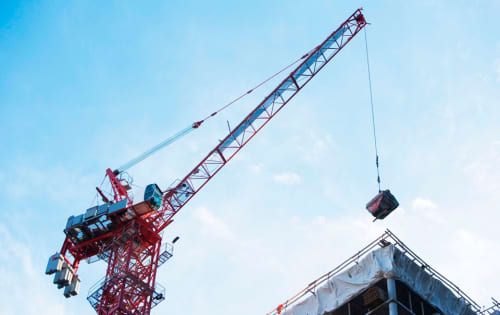 Tower crane moving a load
