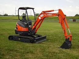 mini excavator parked on grass