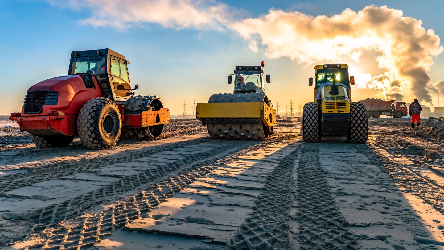 Compaction rollers working in a row