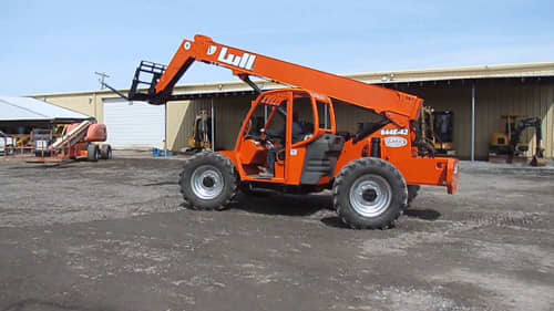 Material handler in front of a warehouse
