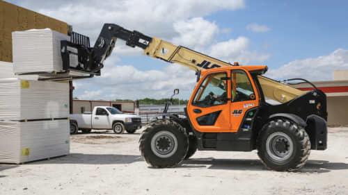 Telehandler lifting an object