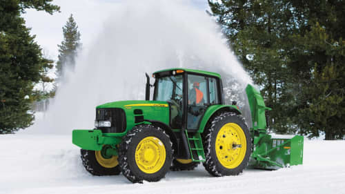 Tractor connected to a mobile snow blower