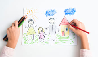 Child drawing her family