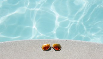 Sunglasses and Swimming pool on hot day