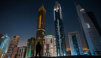 Man looking at Dubai skyline