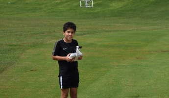 Boy with drone on Golf course