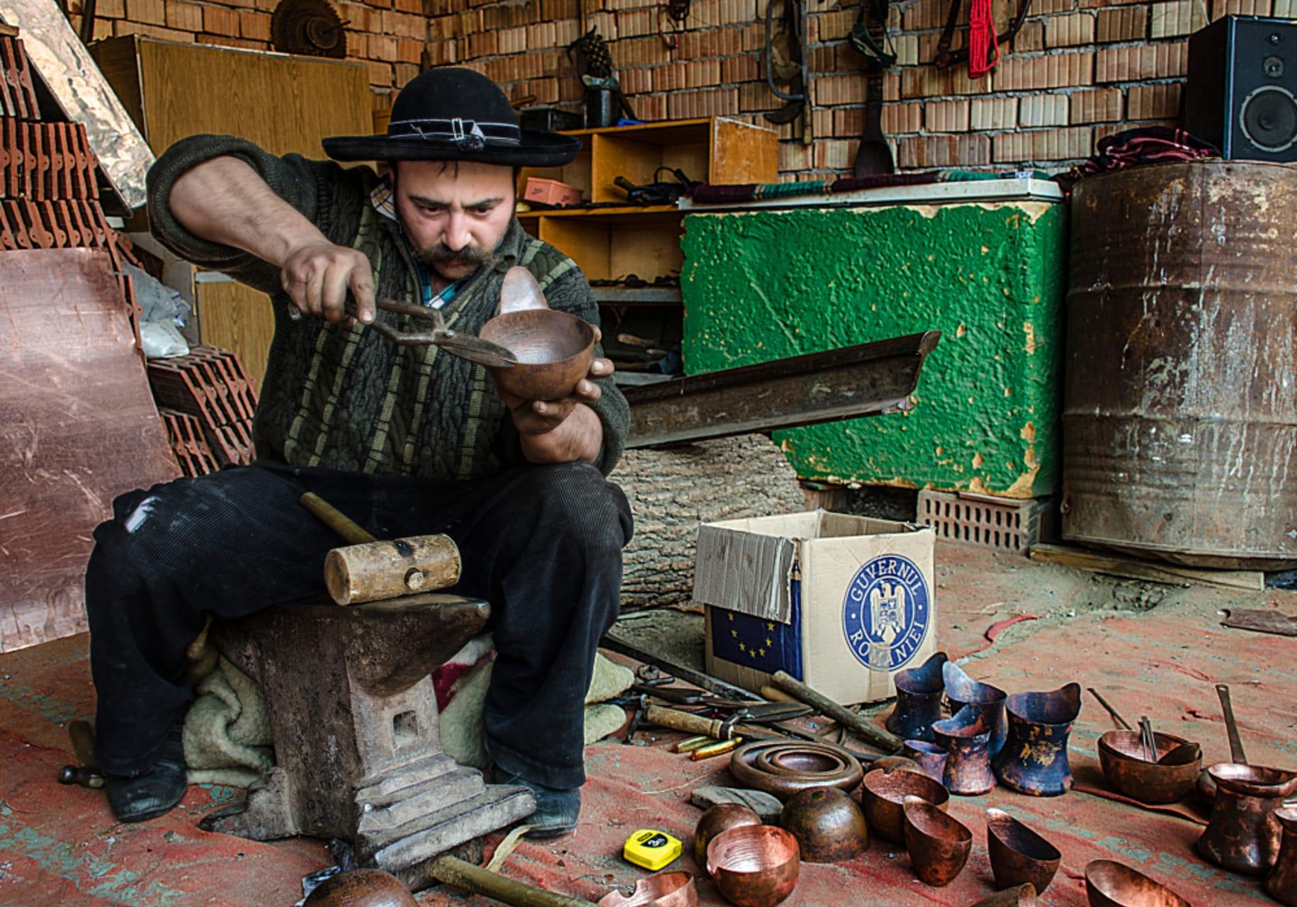 Transylvania - A Coppersmith within a Roma family in a small village of Transylvania