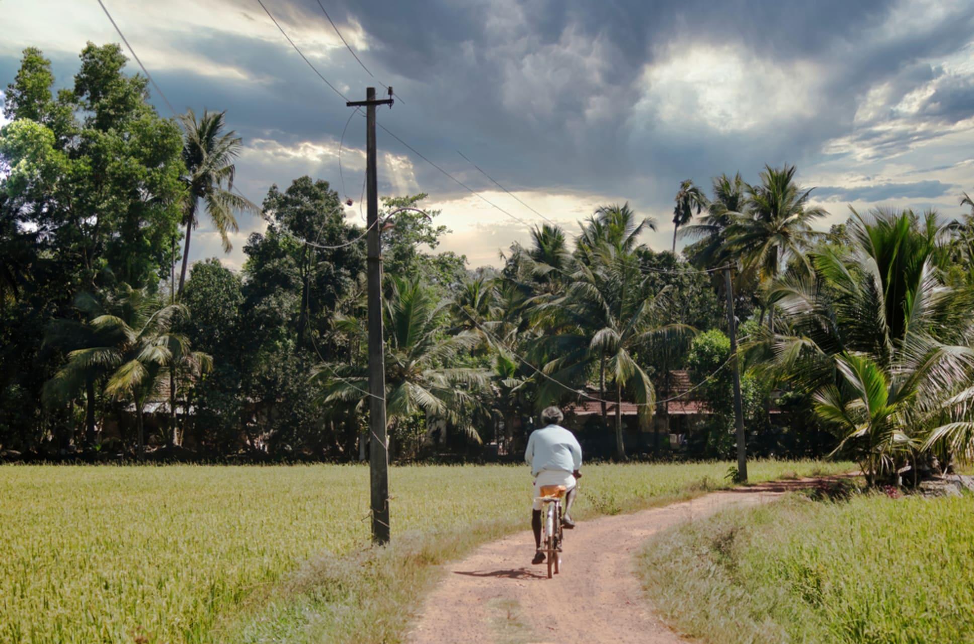 Kerala - Kerala; Bike ride through Riverside Town