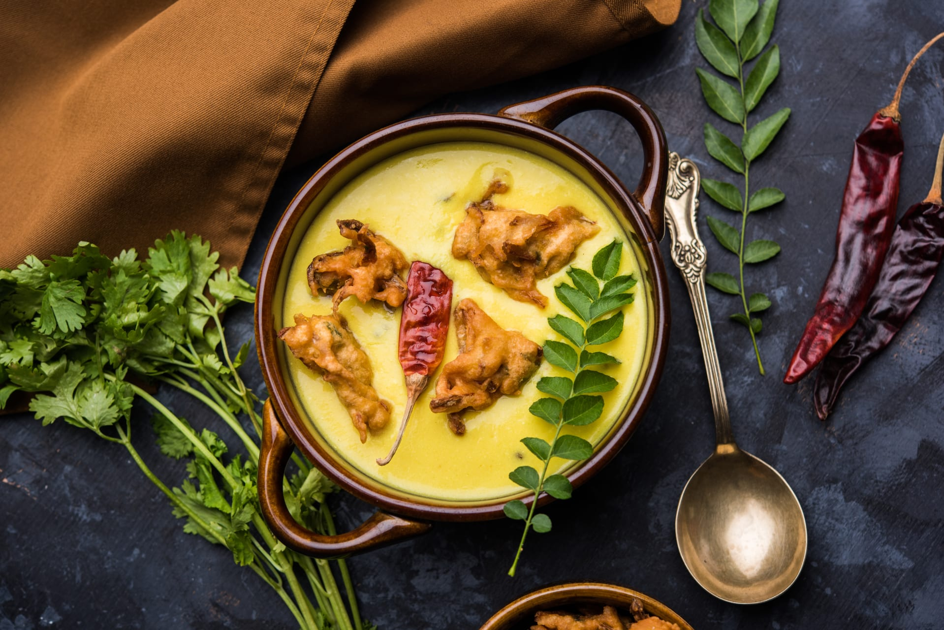 Delhi - Kadhi Pakora- A Famous Tangy Flavorful Indian Curry with Rice