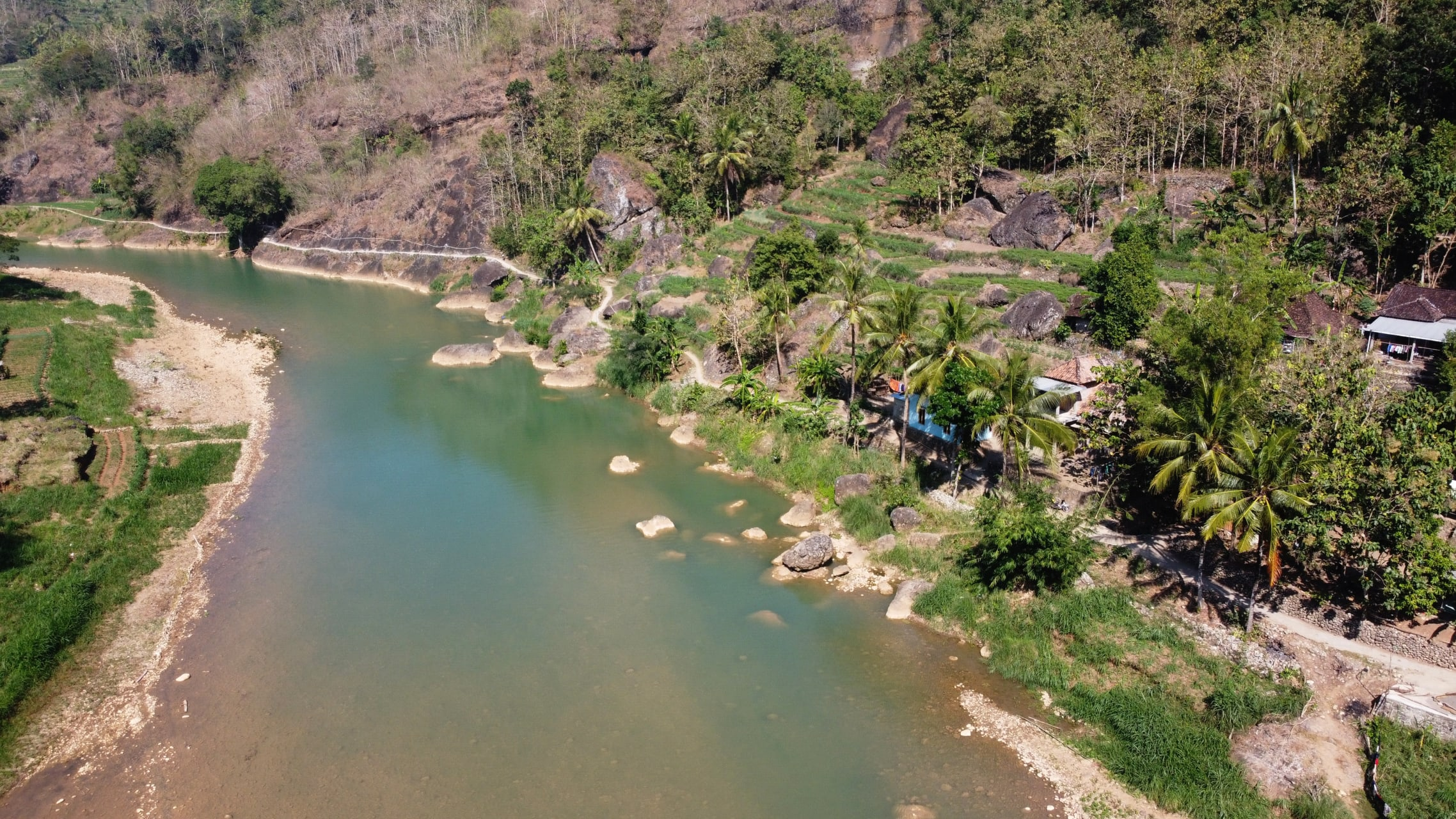 Yogyakarta - The Natural Beauty of the Oya River Valley Flanked by Karst Hills
