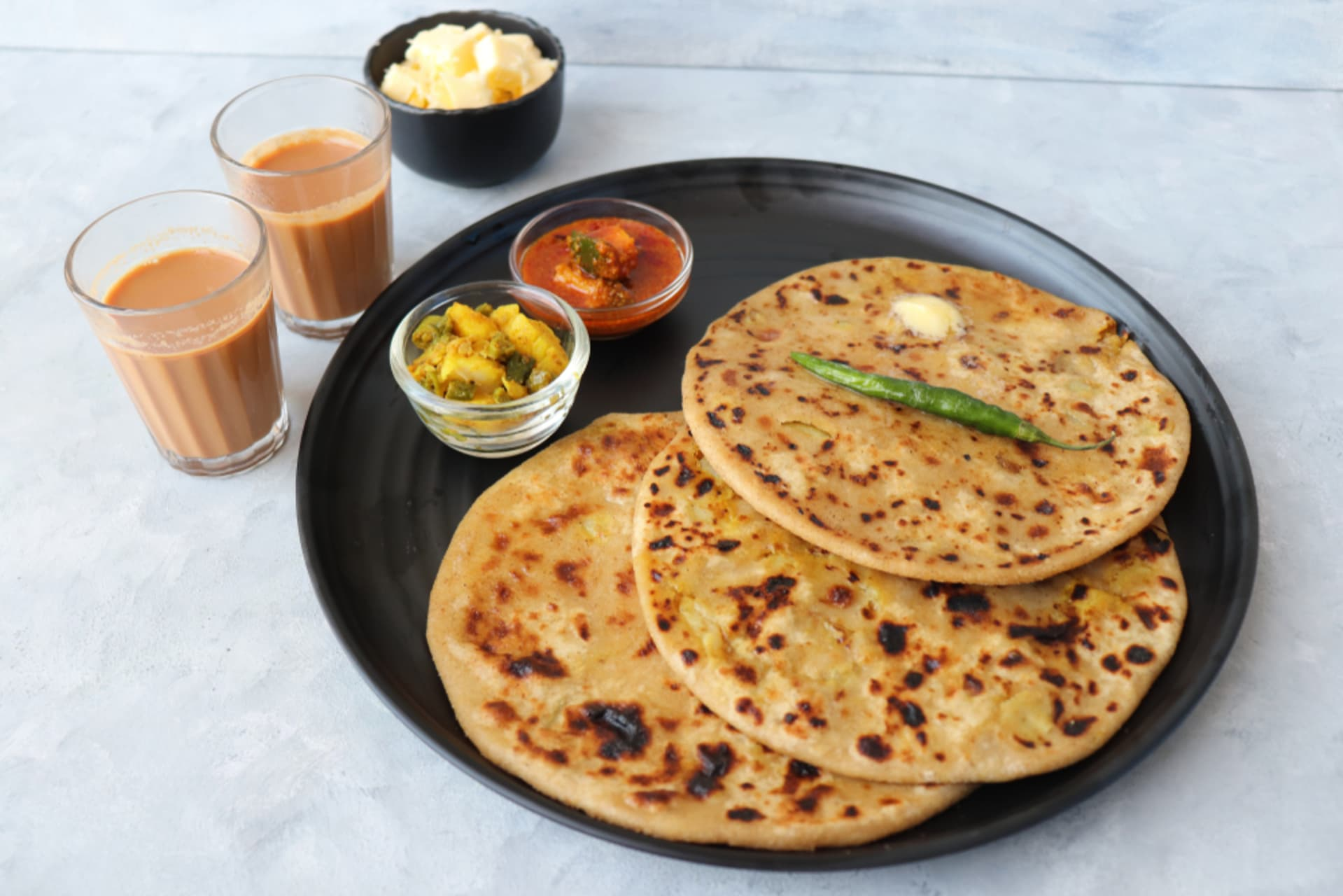Delhi - A perfect Indian Breakfast Combo- Masala Chai with Paranthas