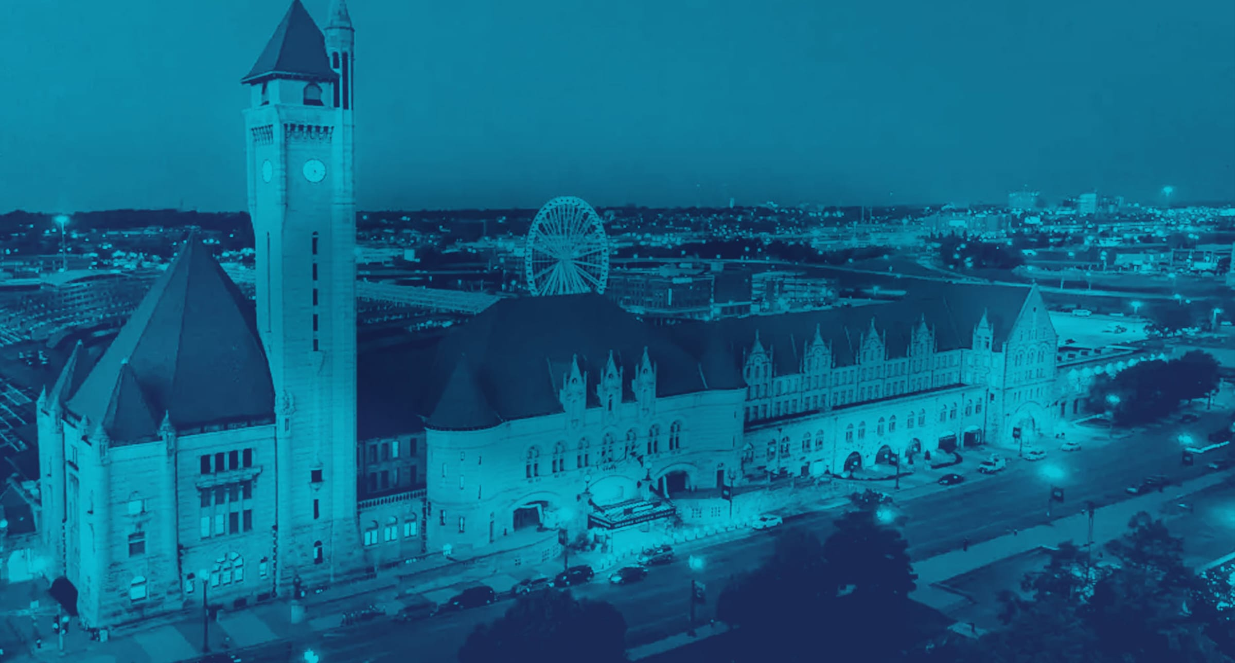 Blue duotone drone image of the St. Louis Union Station