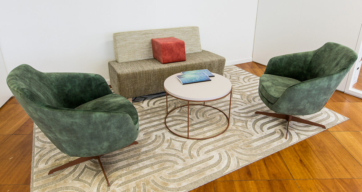 lounge with 2 lounge chairs, carpet and a bench