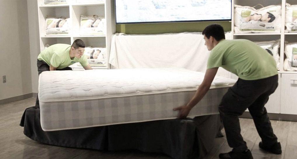 Men flipping a mattress
