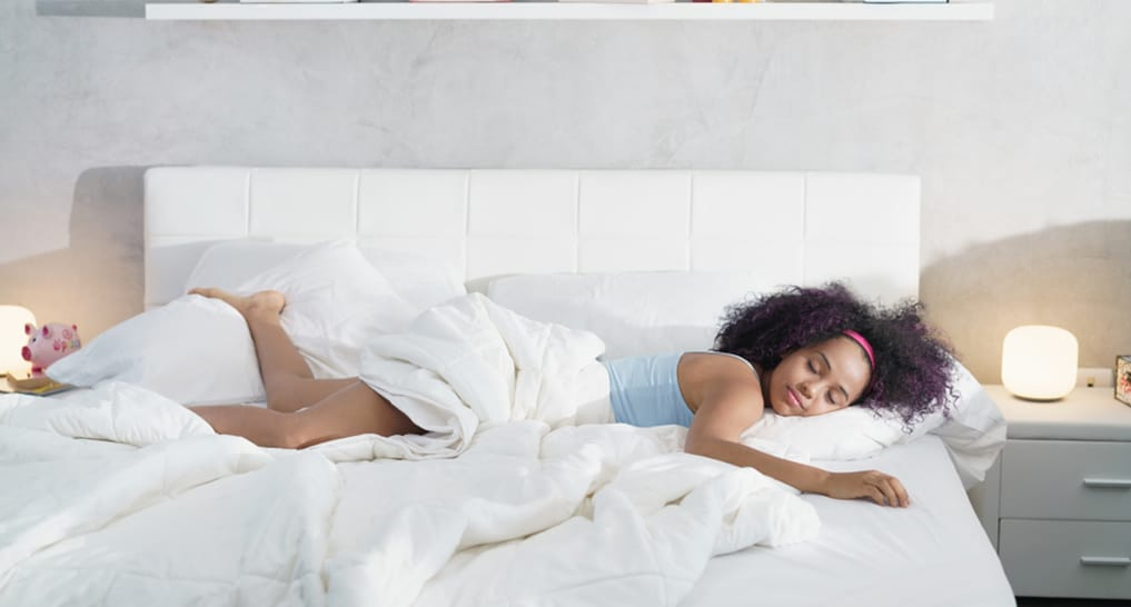 Woman sleeping on a clean mattress