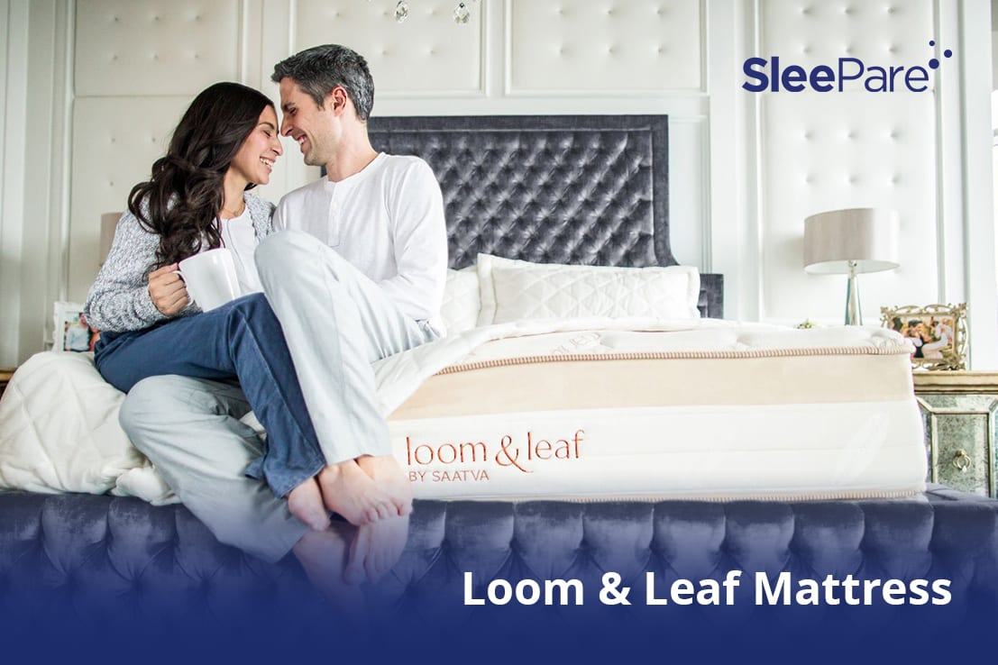 A couple sitting happily on Loom & Leaf Mattress