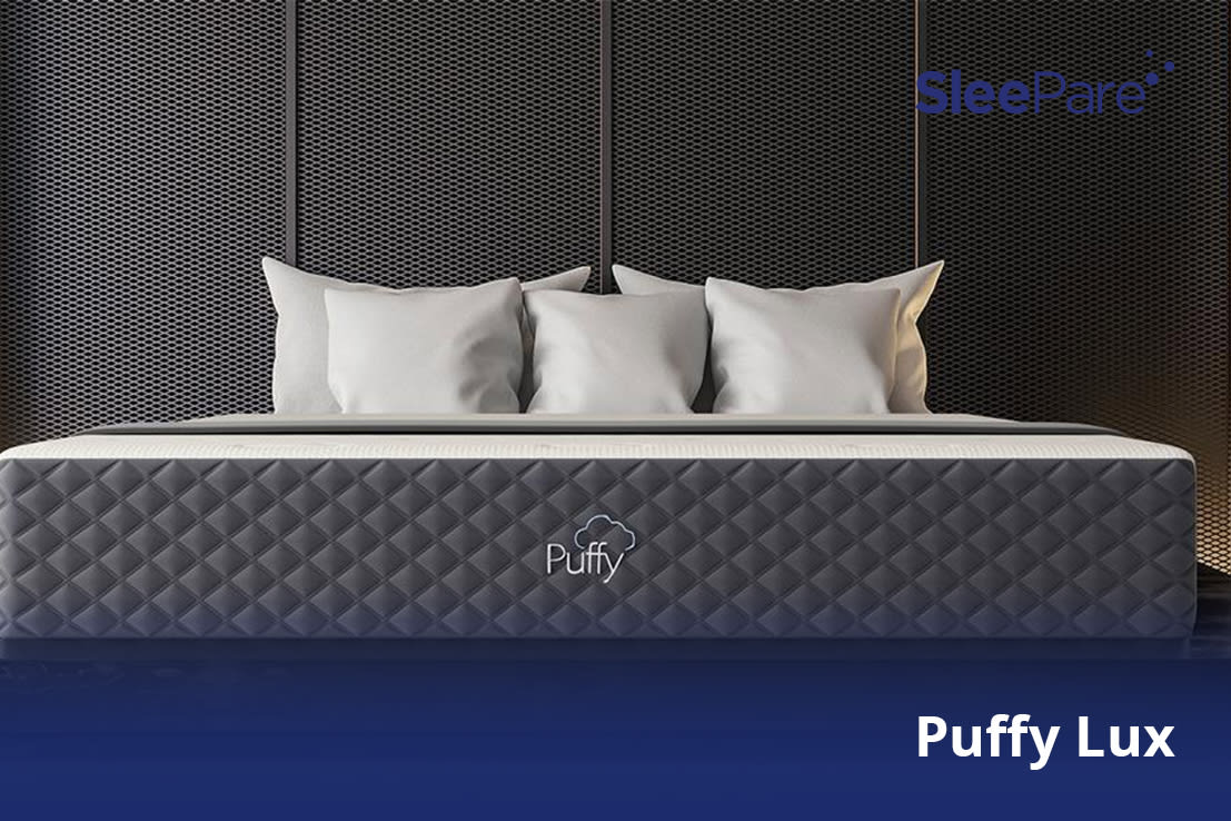A Puffy Lux Mattress shown with pillows on top