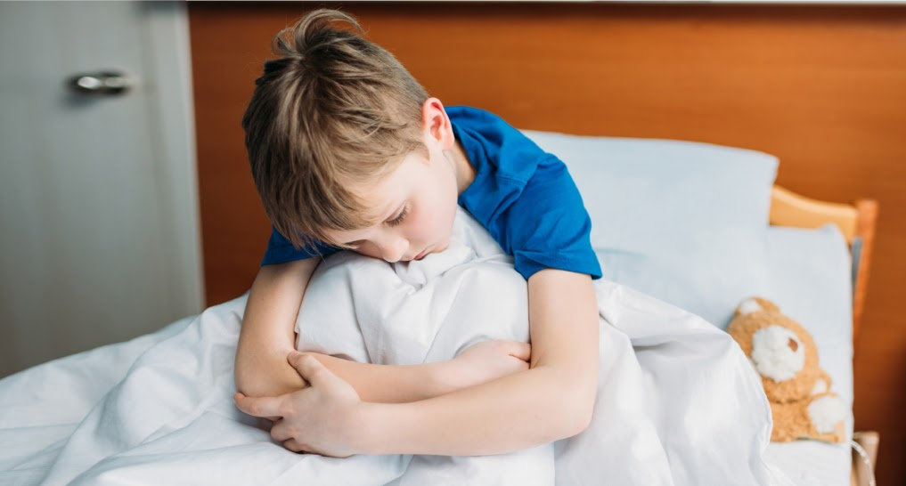 a child feeling bad about wetting bed