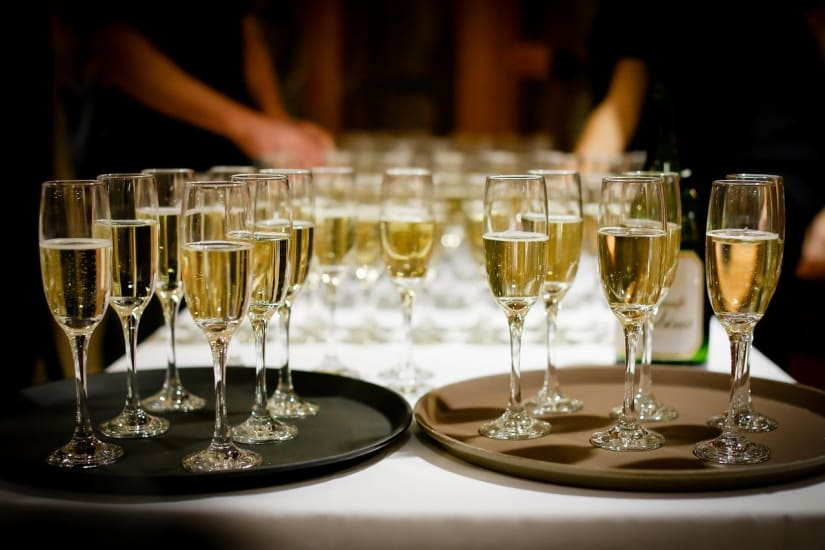 Brut vs extra dry Champagne glasses on a tray