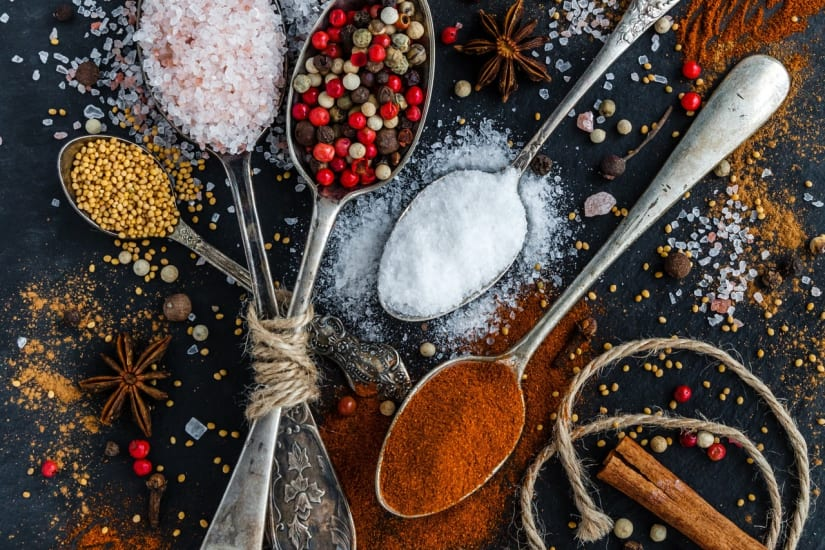 spoons with spices reminding of wine with spicy food