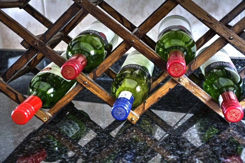 Wine bottles on a wine rack showing how to store wine