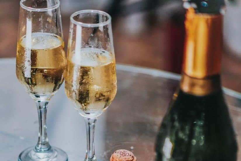Prosecco vs Champagne compared with two sparkling wine glasses