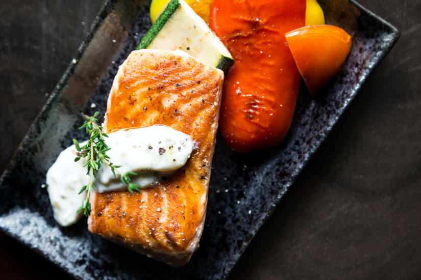 Grilled salmon with vegetables showing the way salmon is cooked influences the best wine with salmon