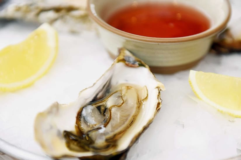 oysters with hot sauce and lemon
