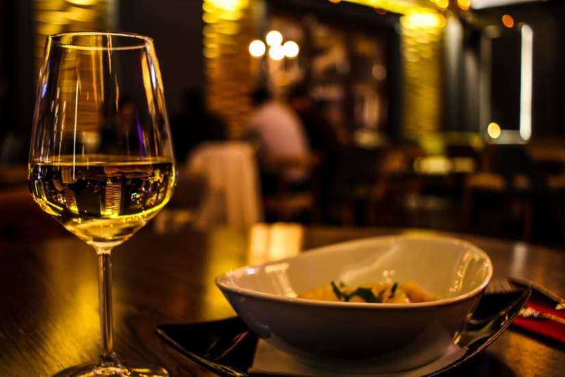 A glass of Pinot Gris and food