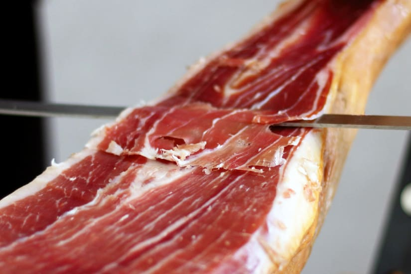 prosciutto being sliced