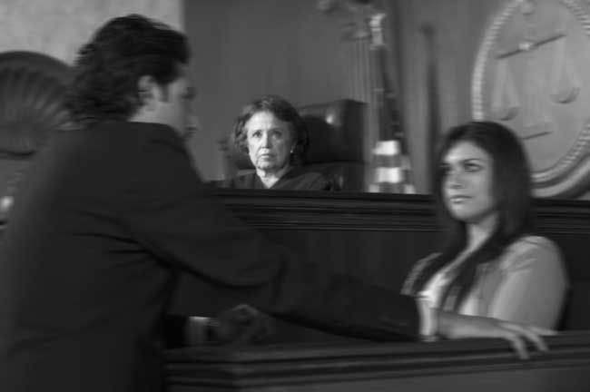 Drug possession trial as the attorney interrogates a witness while judge looks inside the courthouse in Chicago
