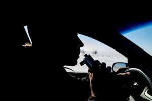 Guy doing a breath test inside his car
