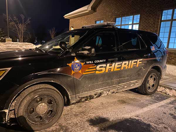 Will County Sheriff vehicle parked in a snow day