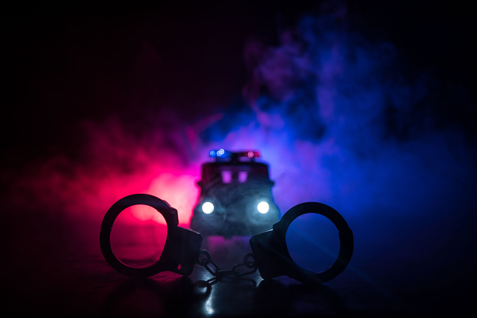 DUI arrest, cop car with fog in the background