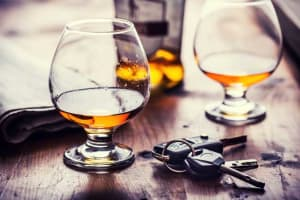 Couple of whisky glasses & car keys on a table