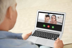 Parent video chatting with kids due to covid-19