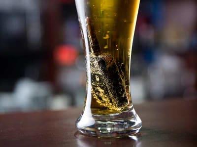 Car keys inside a beer glass