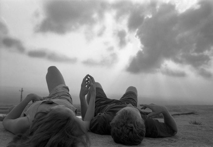 Mark Steinmetz, Stone Mountain, GA (couple lying on rock)