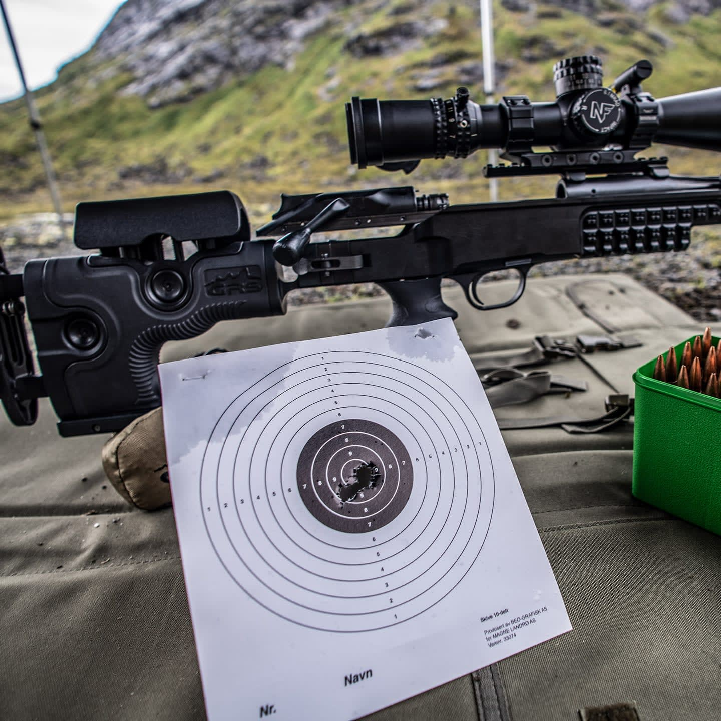 Photo of Ragnarok on Longrange, with good grouping on target over a shooting mat