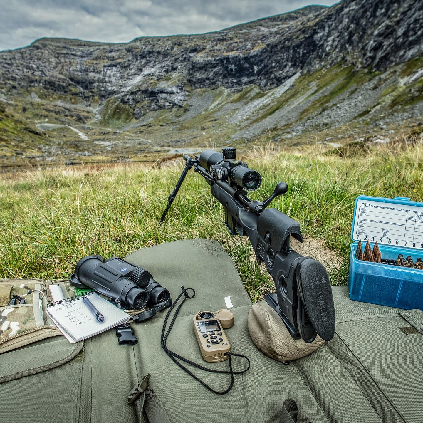 Photo of GRS Bifrost complete rifle, on Longrange, with binoculares and wind gauge